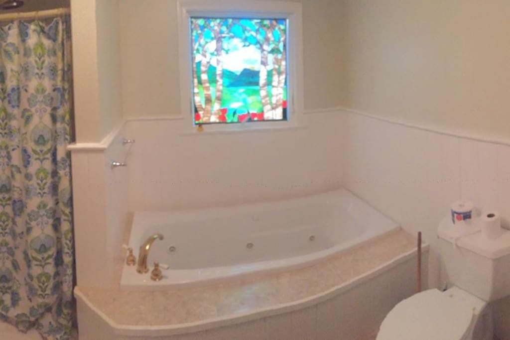Remodeled bath with jacuzzi spa tub