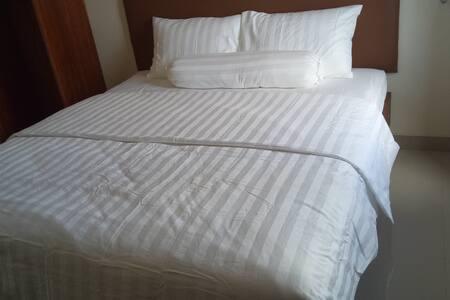 Queen Bed with Duvet