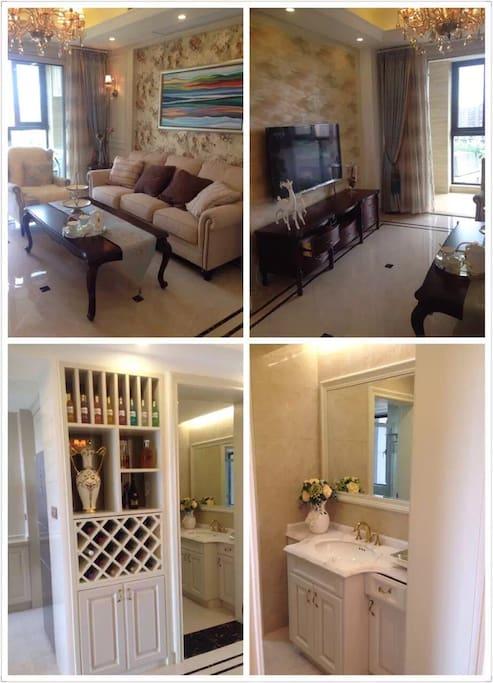 客厅,酒柜,干湿分离的洗手台,全部是樱桃木装修,台面是法国进口的粉红玫瑰大理石。