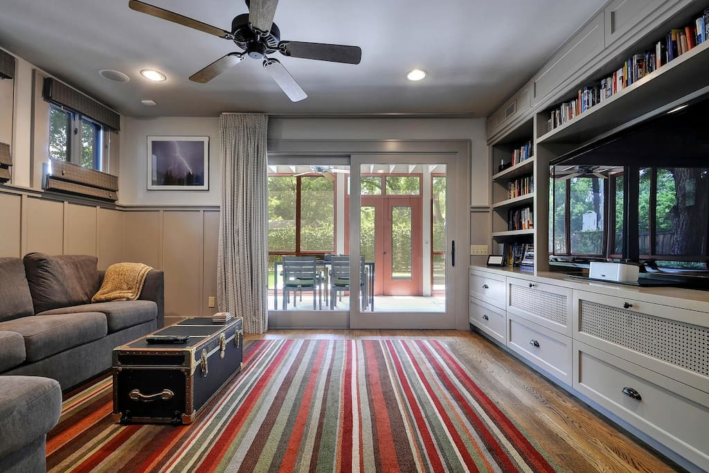 Sliding glass doors lead to a beautiful screened-in patio.