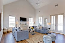 Open, airy, and bright living room in this brand-new home, professionally managed by TurnKey Vacation Rentals.