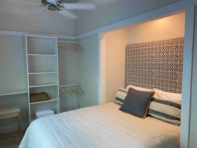 Guest bedroom with Queen bed and dedicated mini workspace.