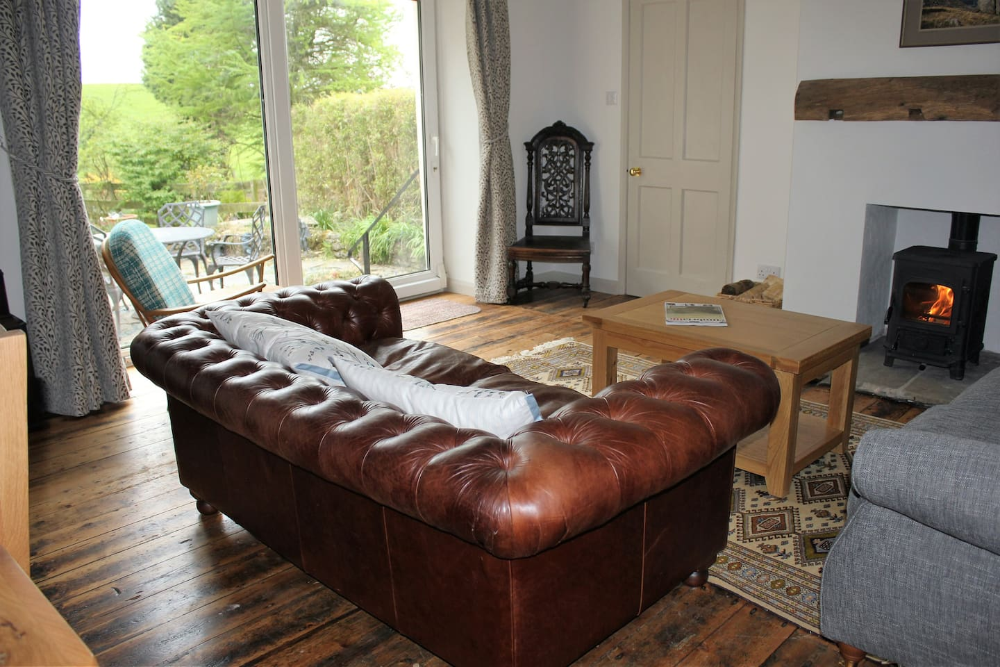 Beautiful cosy living room with patio doors to the garden. Oak beams, original wooden floor. Peace and tranquility.
