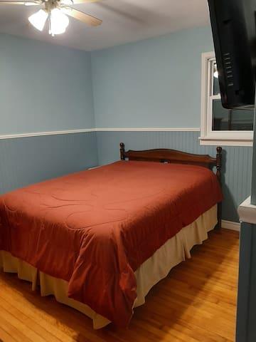 Master bedroom, queen bed and tv