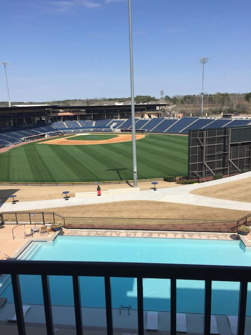 This is the view from the balcony overlooking a saltwater pool and the Gwinnett Braves