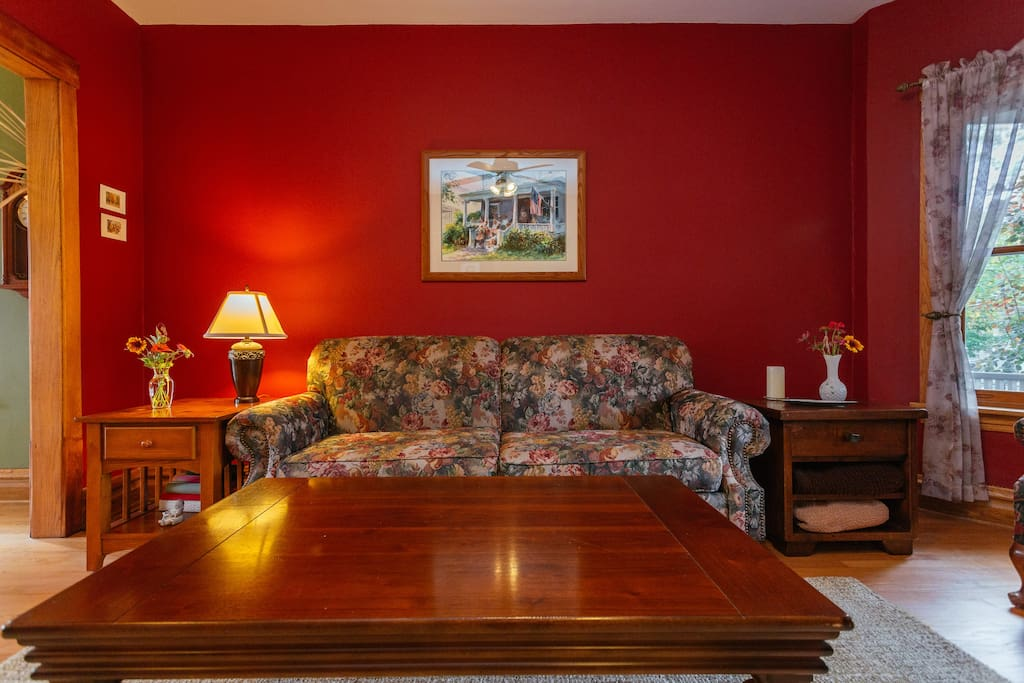 The red living room greets you.