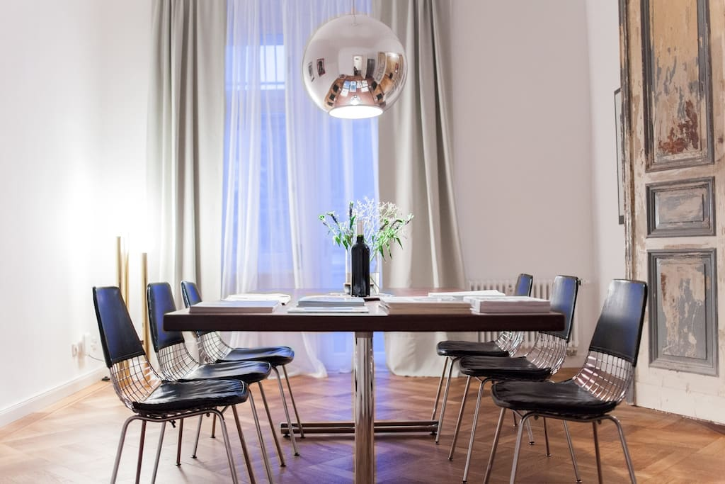 Dining/ Working area:   Designer mirror ball lamp by Fontana Arte, 70's designer chairs.