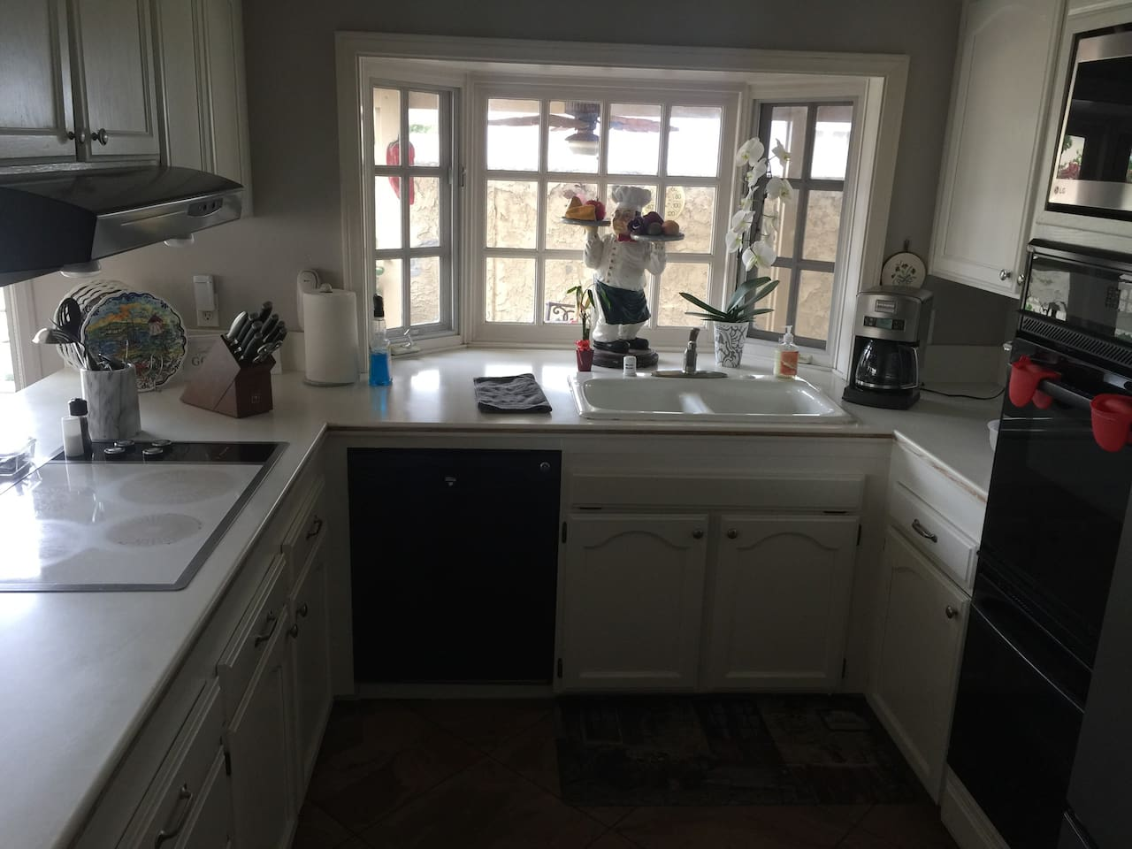 Kitchen with microwave , stove, dual ovens, large refrigerator  with filtered water, Keurig coffee machine and coffee pot to brew coffee. Ceiling fan is useful on warm days.