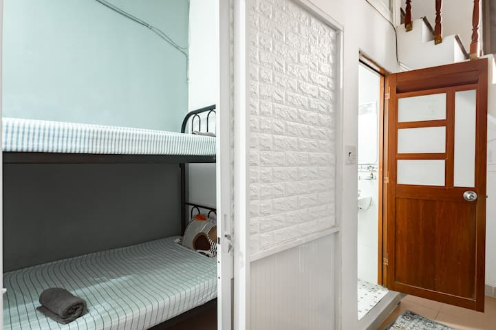 This is the smallest room in the house. There is 2 bunk beds inside. One at the bottom and one on the top. This room is suitable for young people who like the privacy, and just like a space to sleep. The bed is very comfortable for the guests.