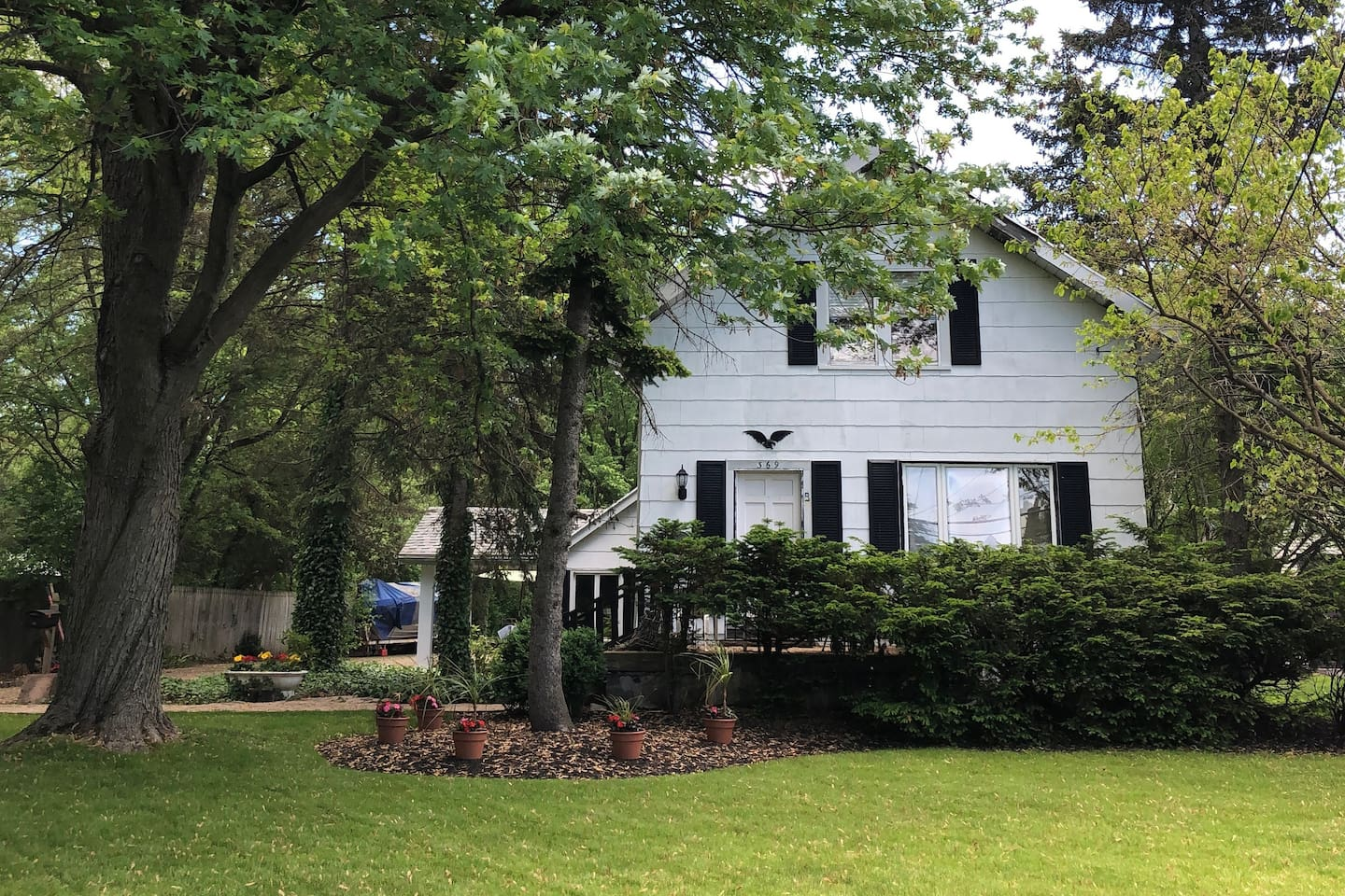 This is the front of our home.  We are set back from the road with an enormous backyard.  It is a slice of country in the 'burbs! The in-law space has its own side entrance.  Joe and Jill live in the front and love to garden.