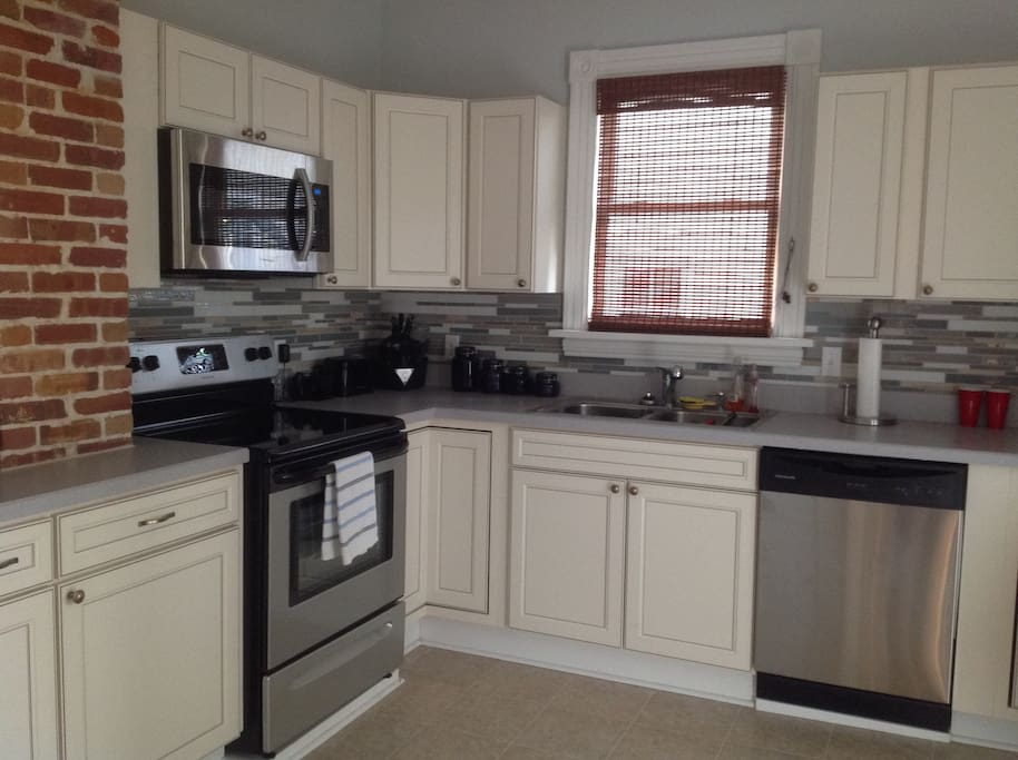 Brand new kitchen with all stainless steel appliances, everything you need for meals.