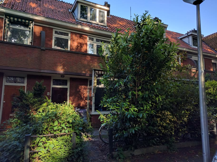 Front of the house, a red brick building in classic Dutch architecture from the 1930s