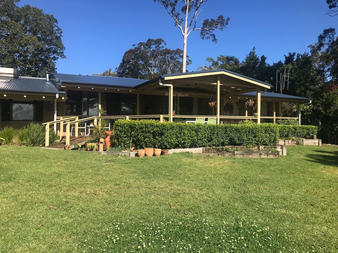 Covered deck opens onto huge garden planted extensively with natives, exotics as well as orchard with citrus, mango, macadamia, mulberry and more ...