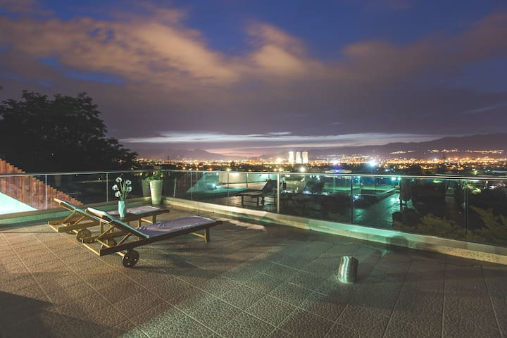 Enjoy the wonderful light-play of the city at night from our Outdoor Pool Deck