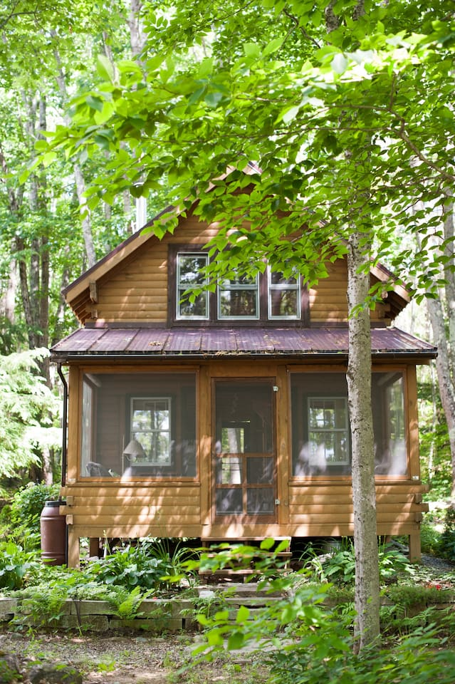 Our cabin at Loonsong is nestled in an oak forest on the shores of Cross Pond. You can swim, boat, fish for bass, or just relax and enjoy the sunset.