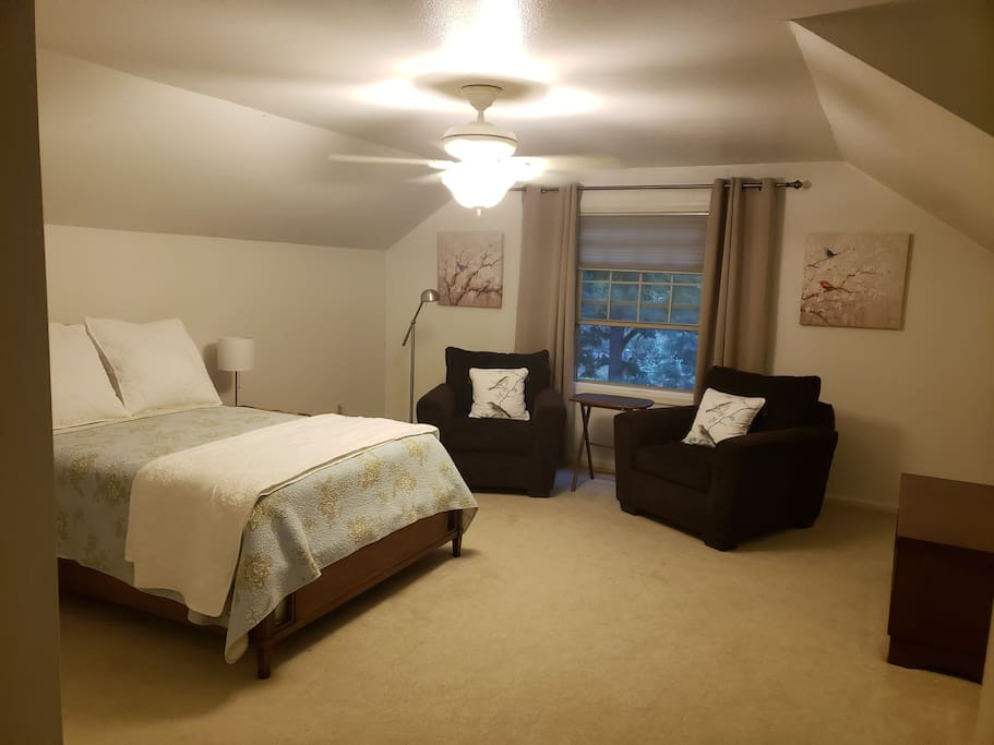 Full size bed with charm! Comfortable chairs to relax on and plenty of space!