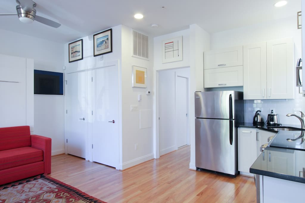 Another view of the kitchen and door leading into the bedroom plus the door on the far left which leads the heating unit. The washer dryer is behind the door in the middle.