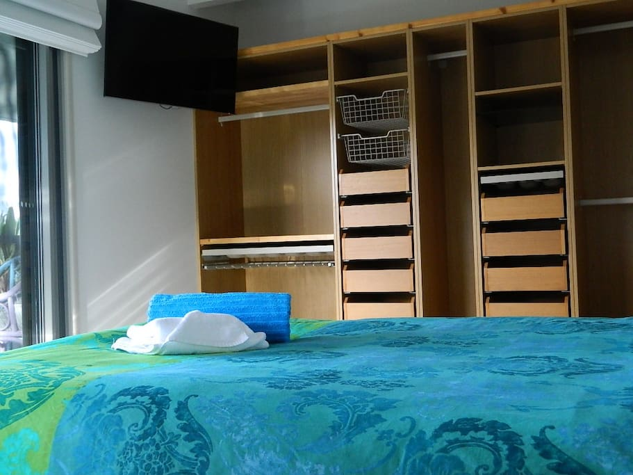 Watch TV from bed. Ample storage for short term holiday stay.