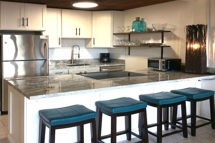 Full kitchen includes electric range, full size refrigerator, microwave oven, toaster, coffee maker, etc.