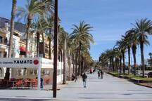 Passeig Marítim and its dozens of restaurants, bars and cafes along the beaches - this is the corner with our street Rambla de Lluis Companys.  This place is one minute to walk from the house.