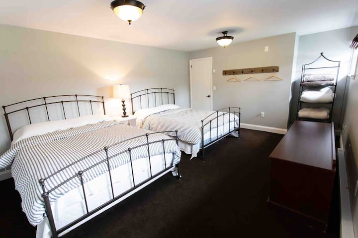 Downstairs bedroom with two queen beds and private entry