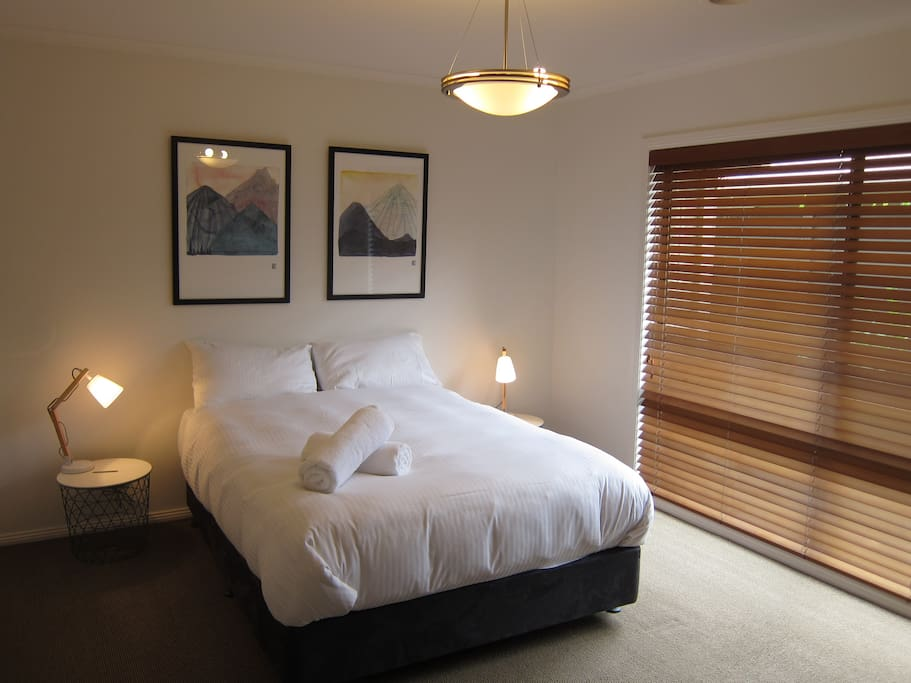 The master bedroom. Queen bed, walk in robe, and ensuite
