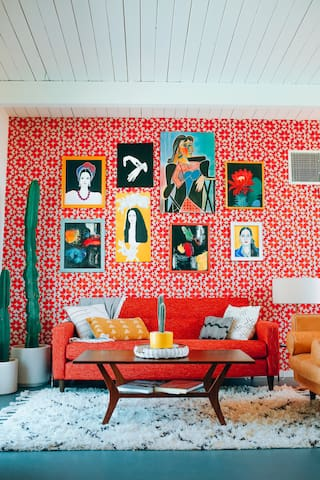 Amazing art wall with wallpaper backdrop. All originals from my Grandmother.