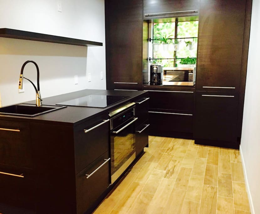 Fully equipped European style kitchen. Can you find the refrigerator?
