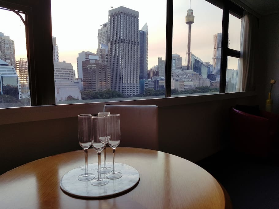 Comfortable Dinning Area For Four Guests with a Hyde Park and Sydney Tower Views