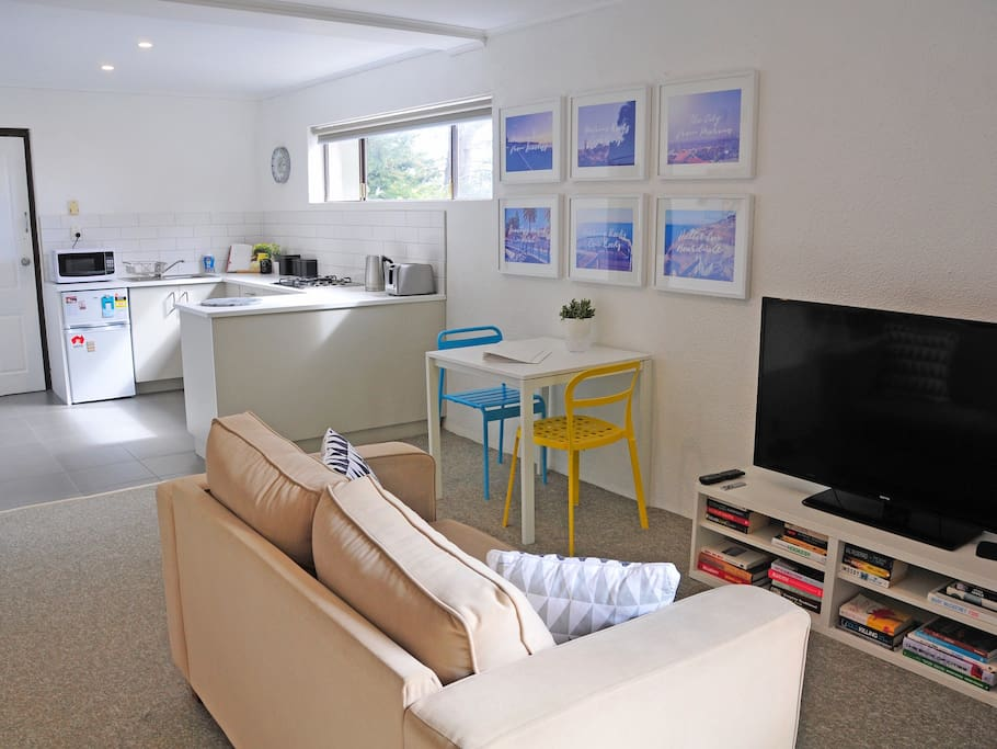 Kitchen, dining and living areas.