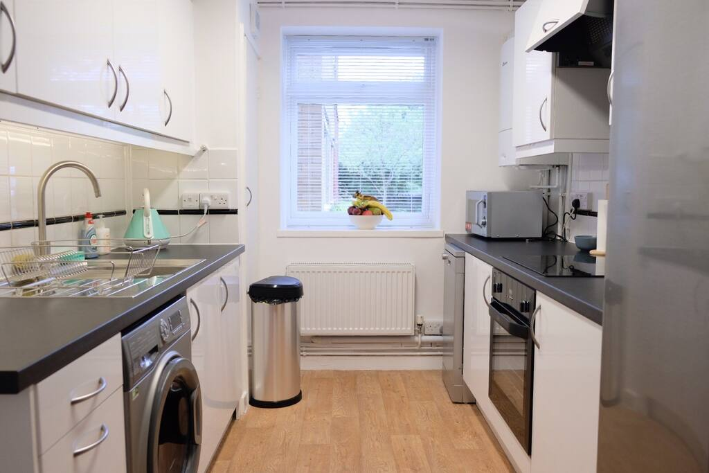 Fully refurbished kitchen with American fridge freezer with water and ice dispenser
