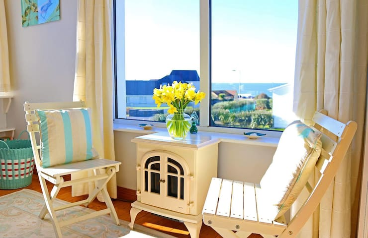 Sitting area in the room with sea view.