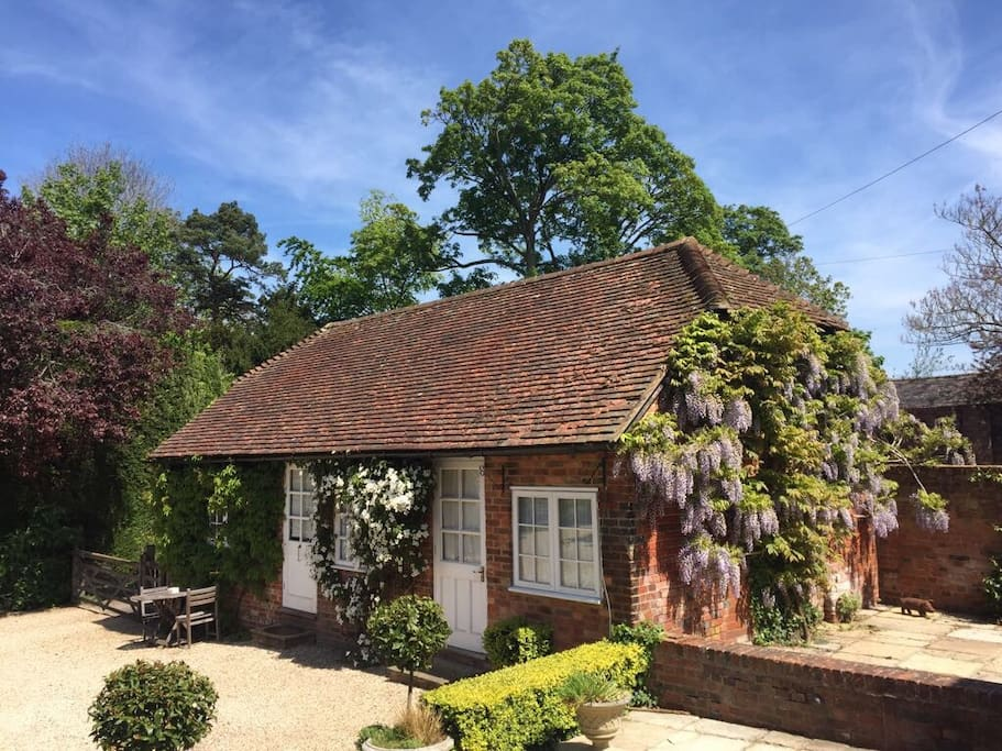 The cottage with its beautiful wisteria and outside sitting area for alfresco dining or just sitting and taking in the views
