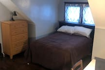 Bedroom includes a full sized bed, dresser, and a desk and a chair in case you need to do some office work.