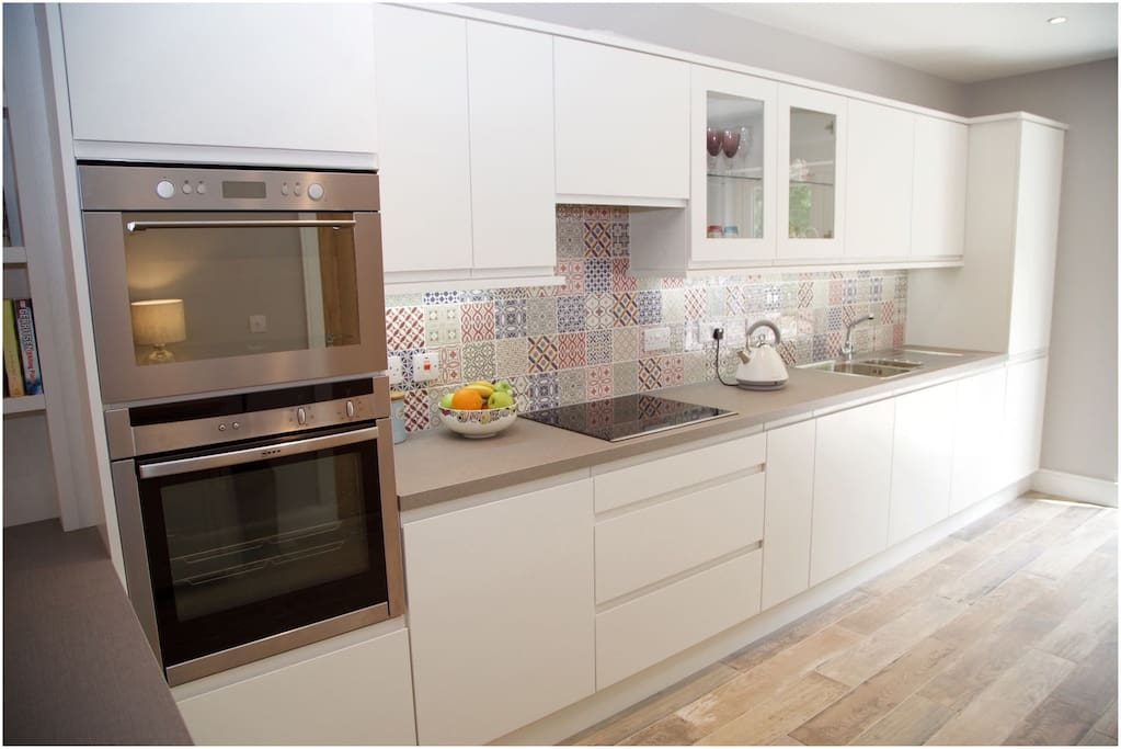 Prepare and cook your meals with ease in this stylish modern kitchen.
