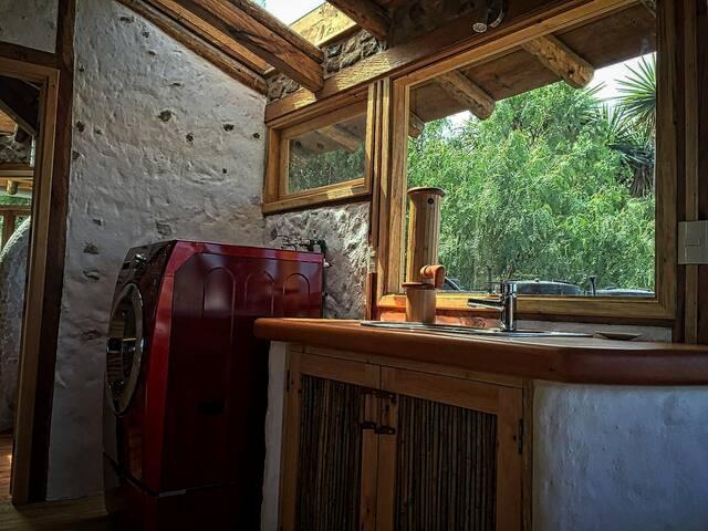 Sunlit kitchen, with efficient washer-dryer