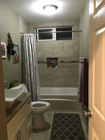 Bathroom for short term rentals is inside the house across the hall from the bedroom