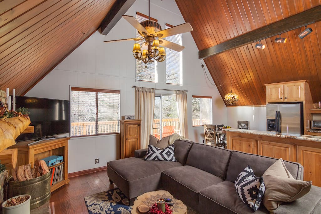 Sunny A-Frame with cozy couch and fireplace with open kitchen for all to gather around