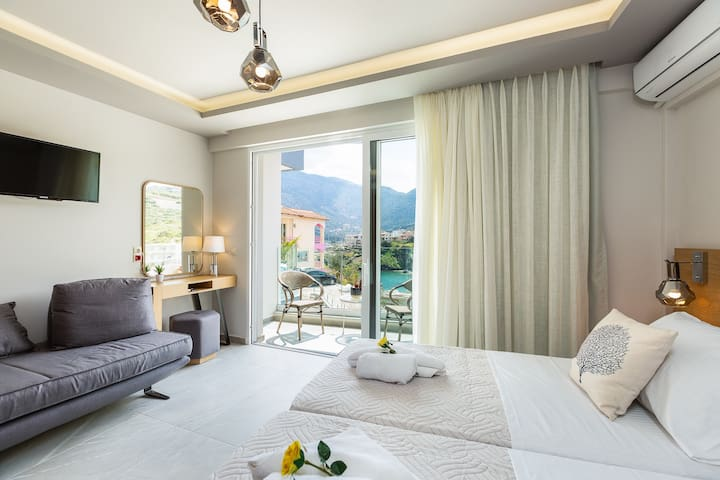 Triple Studio with Sea and Mountain View in Akrogiali Luxury Aparthotel