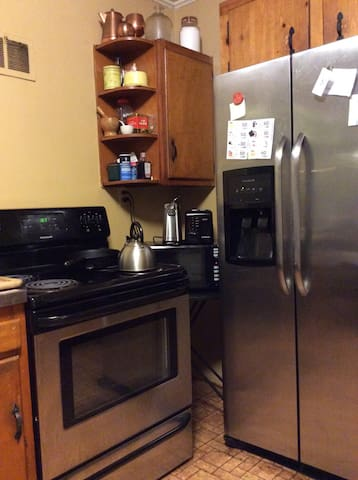 Stove and refrigerator in kitchen