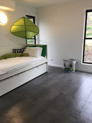 Kids bedroom with single and trundle (second single bed can be pulled out)