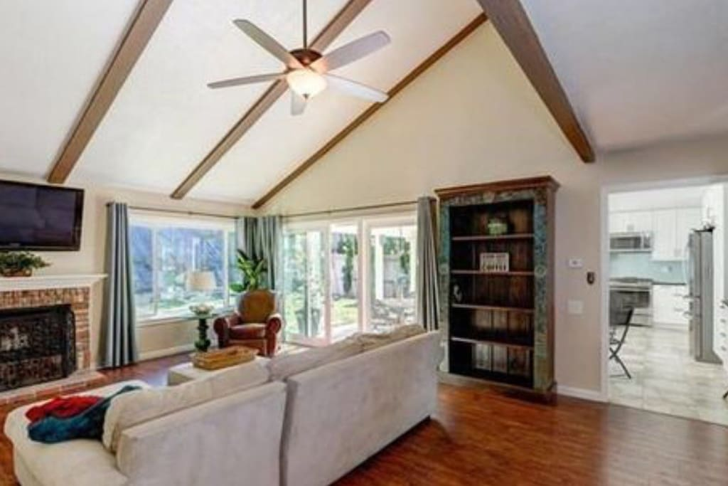 Living room features a flat screen TV, fireplace and a ceiling fan!