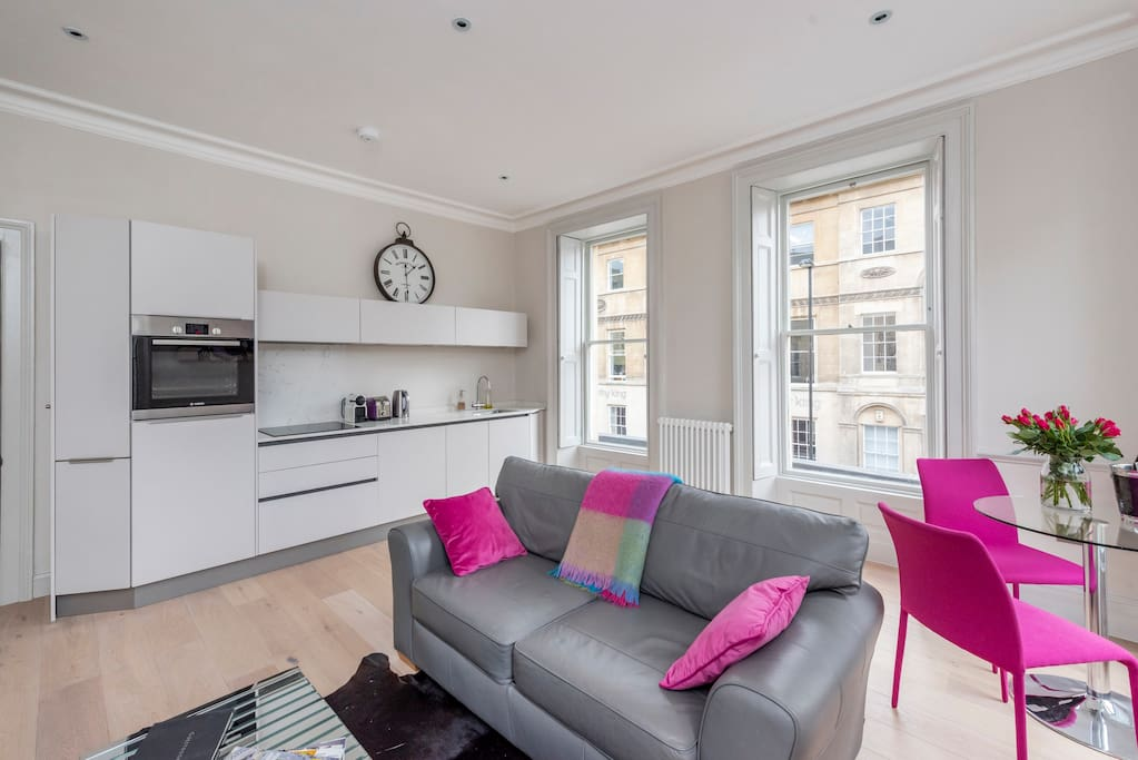 Open plan kitchen and living area with huge Georgian windows overlooking both Queen Square and Wood Street
