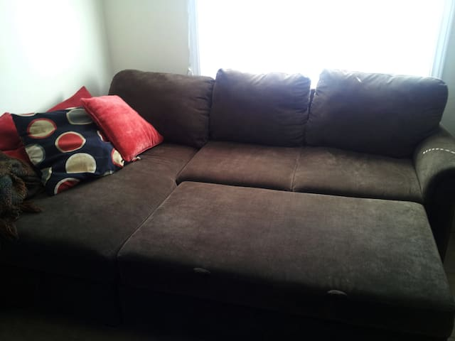 Living room couch pulled out for extra sleeping