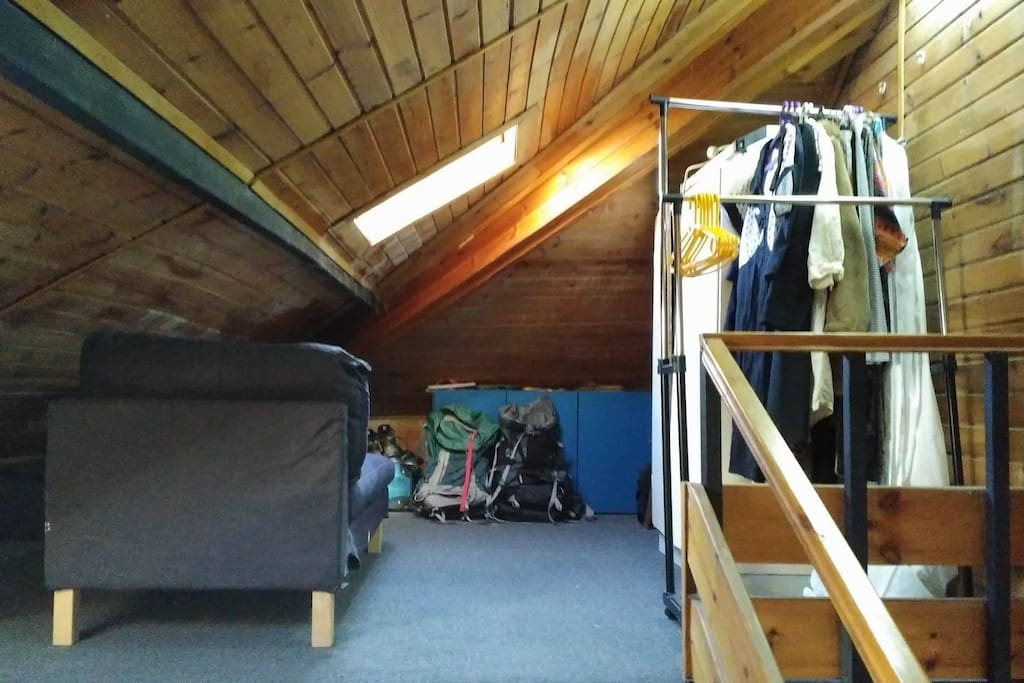 Second half of loft with hanging storage space for you and a day bed