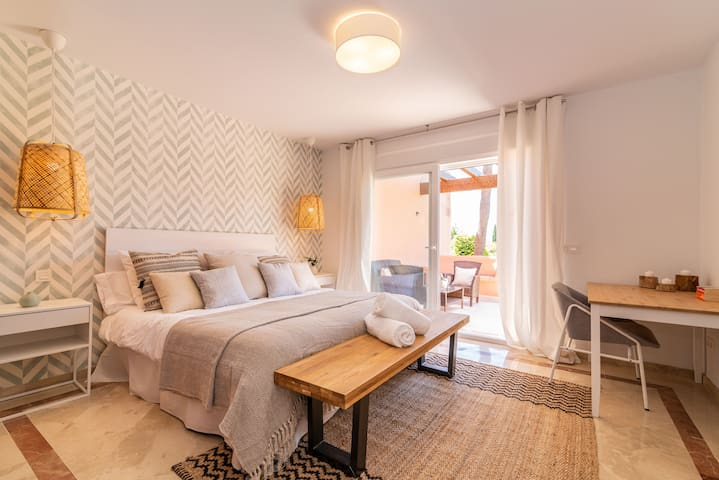 King-size bed (180 x 200 cm), private terrace with serene sea views, and en-suite bathroom with stand-alone rain shower, Jacuzzi and bathtub.