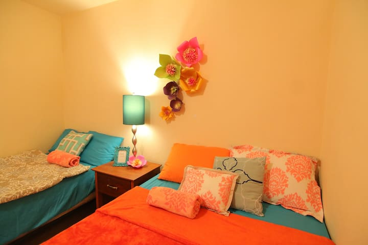 Bedroom #1 accented with handmade flowers.