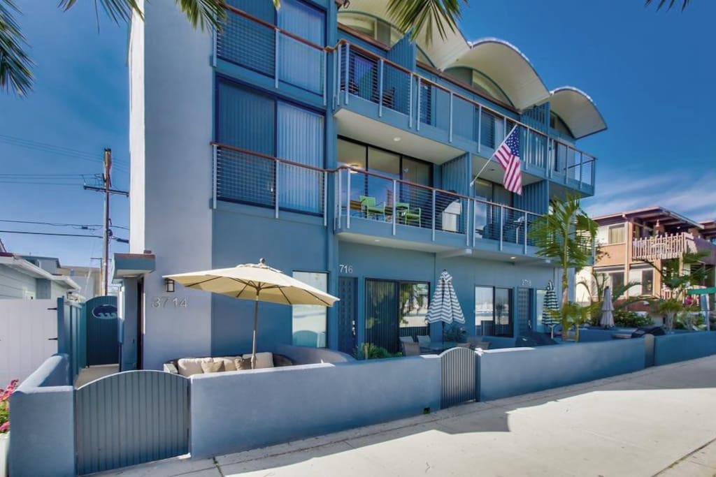 Great location on right on Bayside Walk and across the street from the beach