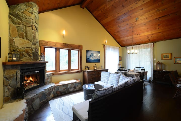 Stone Fireplace with wood boxes/benches & seating area