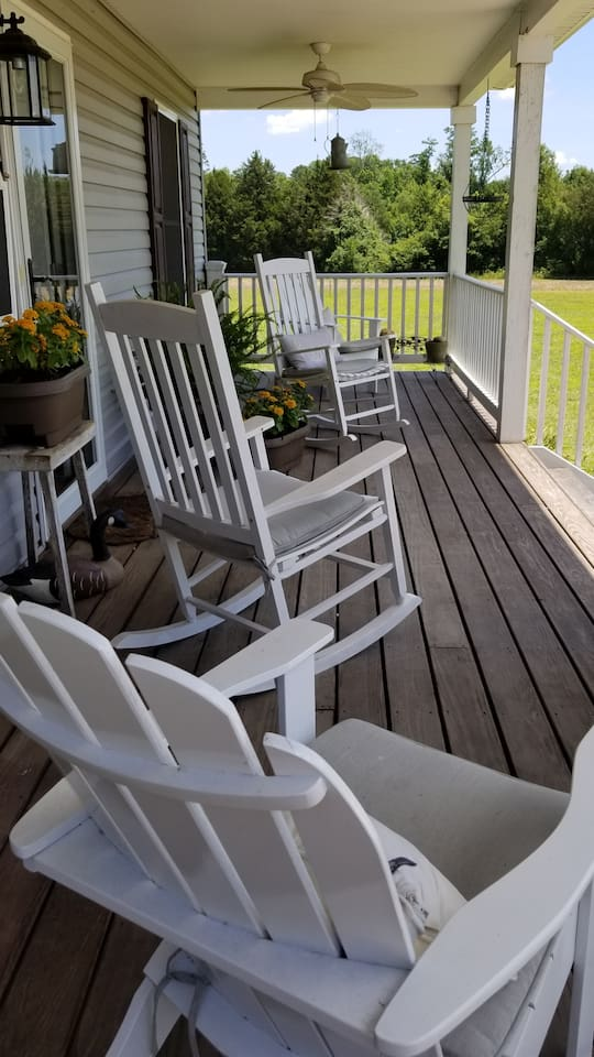 A breeze is always present on this front porch!  The surrounding view is rural farmland.
